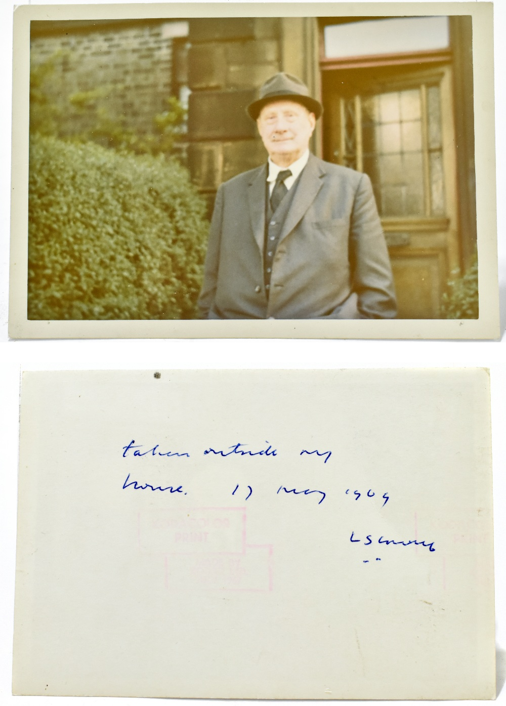 LAURENCE STEPHEN LOWRY; inscribed and signed colour photograph of the artist standing outside his