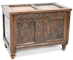 A late 17th century oak coffer chest with lift-up panelled top above carved frieze, dated 1681,