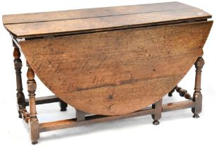 A 19th century oak drop-leaf gateleg table, height 69cm, length when extended approx 150cm.
