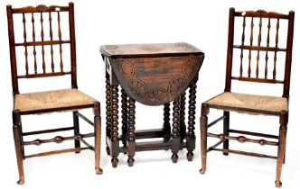 An early 20th century oak gateleg side table with bobbin turned supports,
