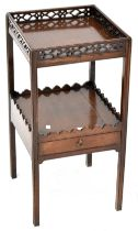 A 19th century mahogany two-tier occasional table with fretwork rim to the top,