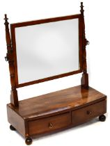 A 19th century mahogany rectangular swing dressing table mirror, turned baluster supports to mirror,