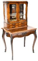 A 19th century flame mahogany bonheur du jour twin glazed display cabinet with glazed panels to