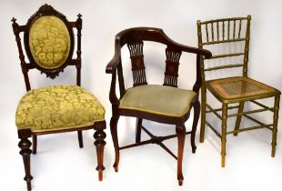 An Edwardian faux bamboo gilt painted bedroom chair with bergère seat,