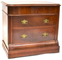 A Victorian mahogany serpentine front three-drawer chest,