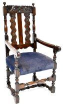 An early 19th century Victorian oak armchair/carver,