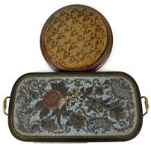 A late 19th century German beadwork tray in black lacquered frame and gilt brass handles,