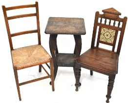 A late Victorian oak hall chair with tiles set to the back,