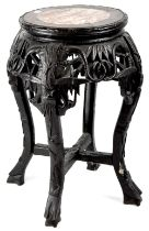 A late 19th/early 20th century Oriental carved hardwood jardinière stand of typical form,