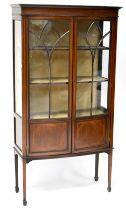 A late Victorian/early Edwardian mahogany bow-front display cabinet with string inlay,