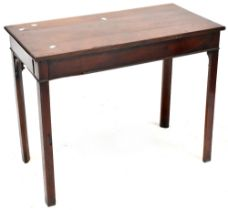 An early 19th century mahogany hall/side table to block supports, length 90cm.