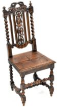 A 19th century oak carved high back hall chair with overall grape and vine carved decoration to the