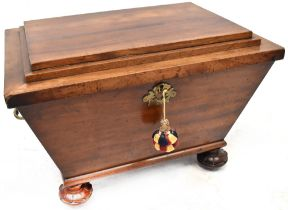 A Regency mahogany cellarette of sarcophagus shape, with stepped lid exposing lead-lined inner,
