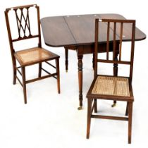 A 19th century mahogany drop-leaf table to turned tapering supports and castors,