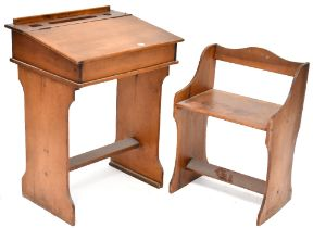 An early 20th century child's desk with push-under seat,