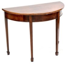 A 19th century flame mahogany demi-lune table, four tapering block supports to peg feet,