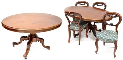 A late 19th/early 20th century mahogany oval dining table on turned baluster and quadripartite