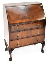An early 20th century mahogany bureau with drop-down desktop,