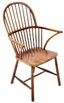 A late 18th/early 19th century Windsor stick back elbow chair with solid saddle elm seat and shaped
