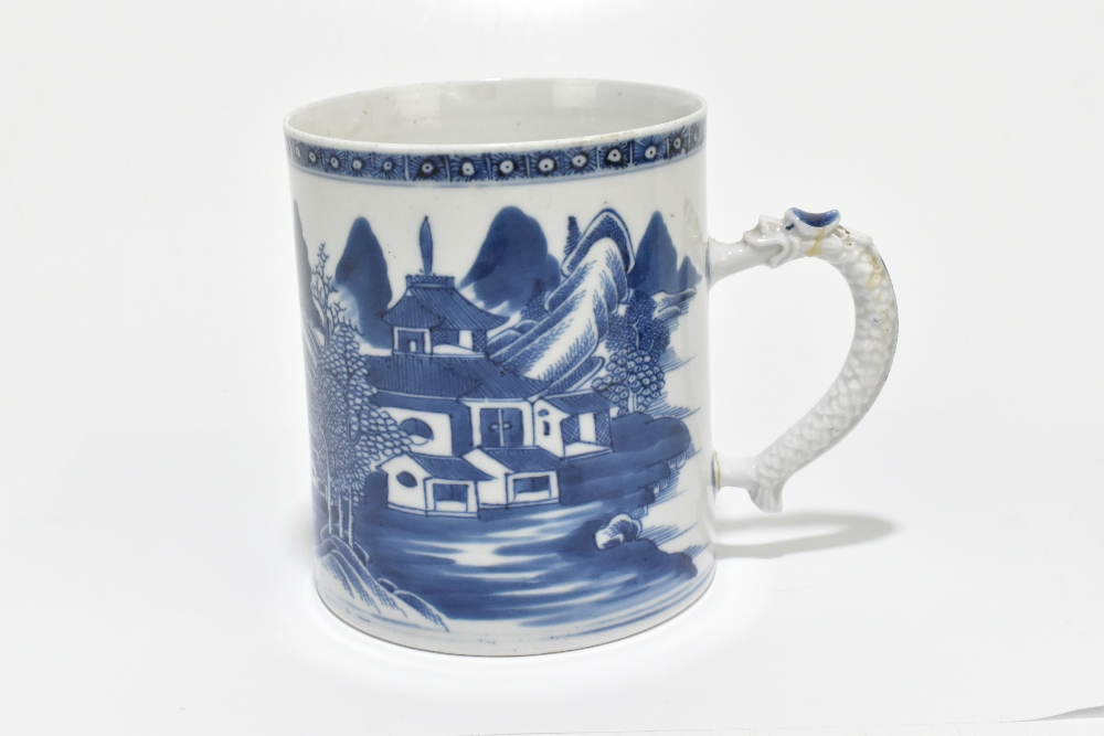 An 18th century Chinese Export blue and white mug decorated with a landscape scene and applied - Image 4 of 13