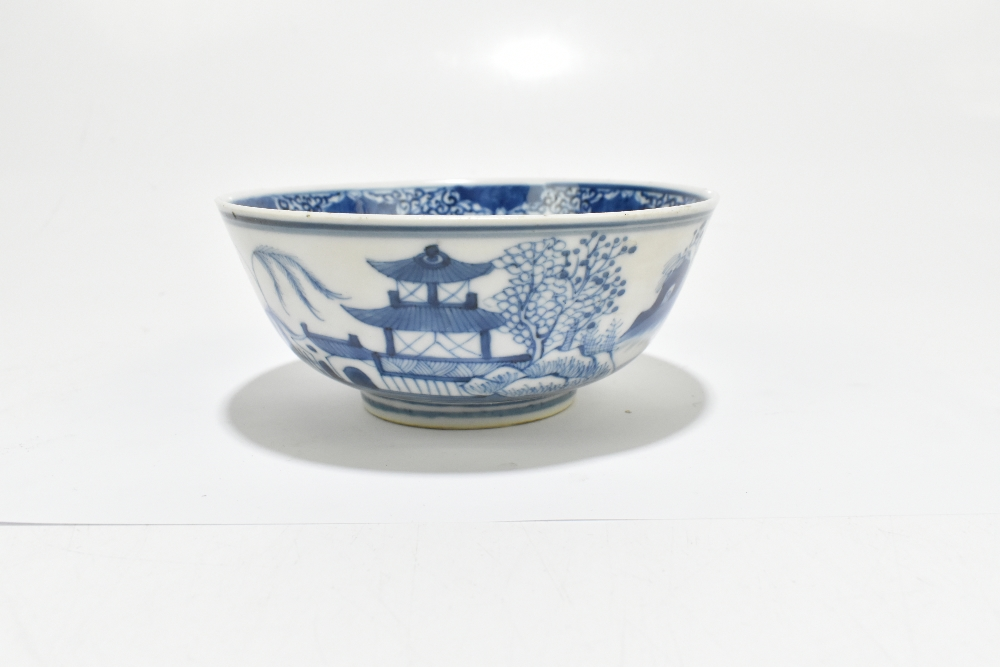 A 19th century Chinese blue and white porcelain footed bowl decorated with objects to the interior - Image 2 of 8