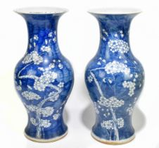 A near pair of 19th century Chinese blue and white porcelain vases decorated with prunus flowers