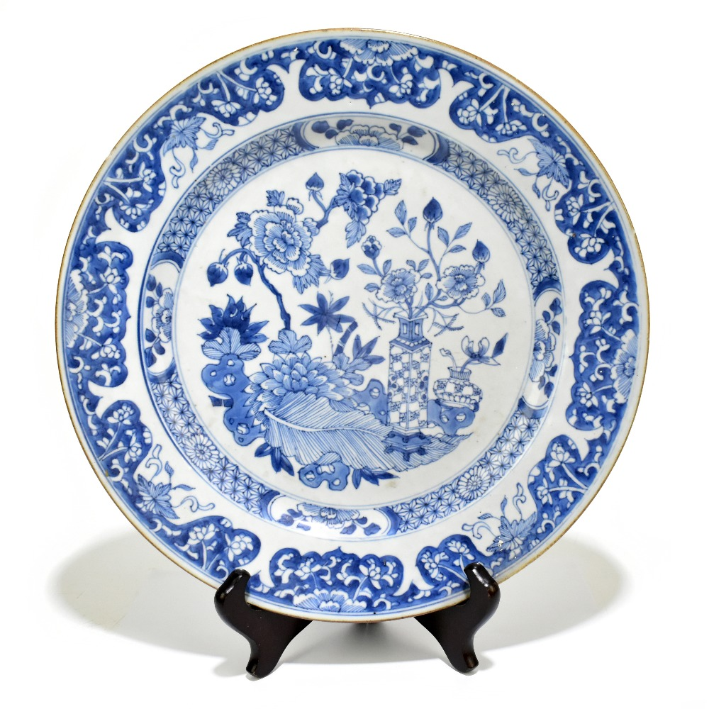 A pair of 18th century Chinese Export blue and white chargers painted with still life scenes and - Image 2 of 4