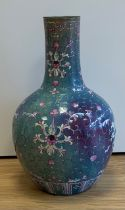 A large 18th century Chinese flambé vase, later enamel painted with stylised floral sprays, base