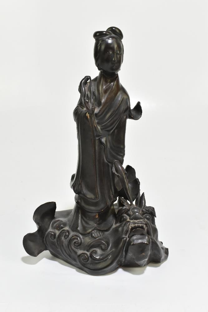 A 19th century Chinese porcelain figure representing Guan Ying standing on a mythical creature, - Image 2 of 6