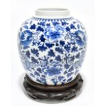 A late 19th century Chinese blue and white porcelain ginger jar decorated with a four claw dragon