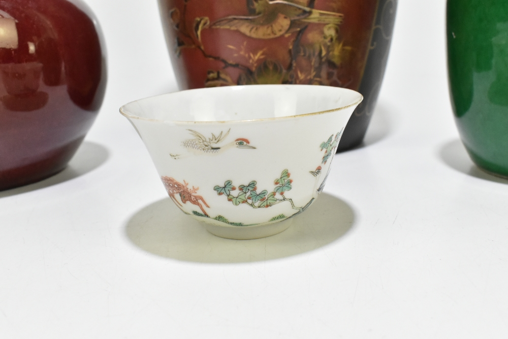 A Chinese Famille Rose porcelain footed tea bowl decorated with deer and exotic birds in - Image 3 of 18