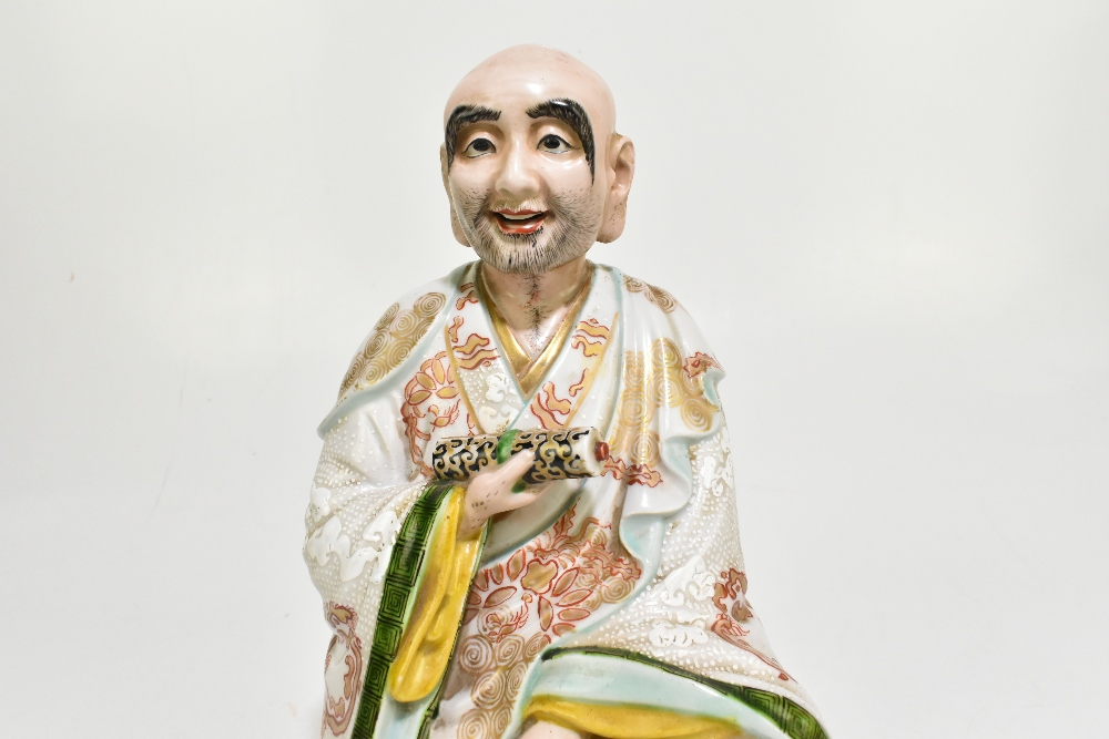 A late 19th century Chinese figure representing a seated scholar wearing a gown with relief and - Image 3 of 7