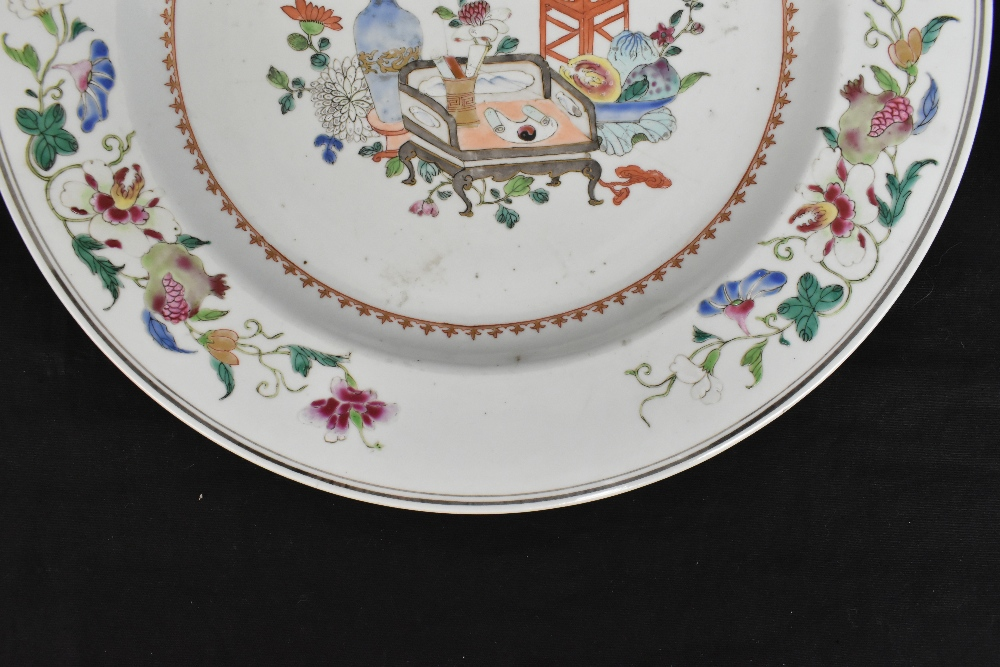 An 18th century Chinese porcelain Famille Rose wall charger decorated with objects to the centre - Image 2 of 6