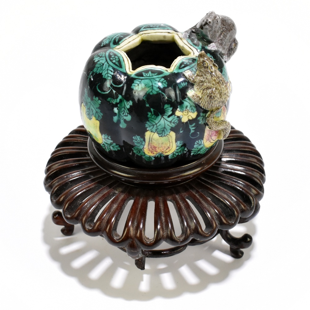 A Chinese Famille Noire ceramic brush pot with moulded decoration of two rats to the body, painted