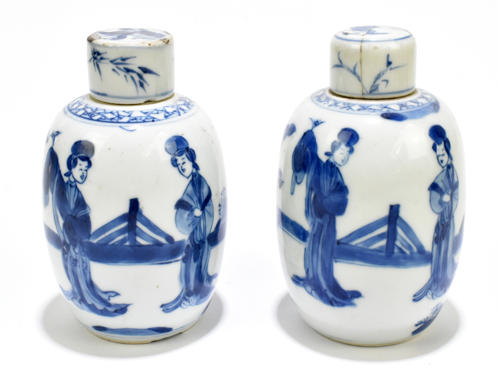 A pair of 18th century Chinese blue and white porcelain tea caddies and covers, painted with maidens