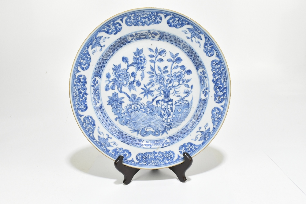 A pair of 18th century Chinese Export blue and white chargers painted with still life scenes and - Image 3 of 4