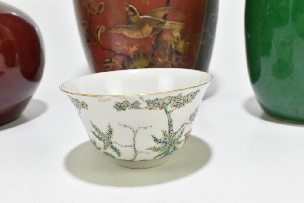 A Chinese Famille Rose porcelain footed tea bowl decorated with deer and exotic birds in - Image 5 of 18