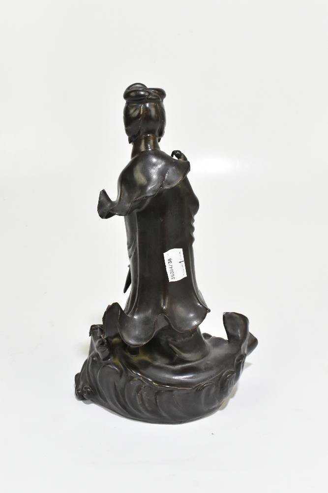 A 19th century Chinese porcelain figure representing Guan Ying standing on a mythical creature, - Image 4 of 6