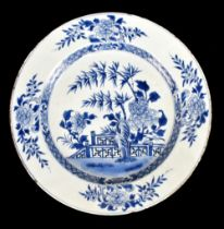 An 18th century Chinese Export blue and white porcelain wall charger decorated with lotus flowers
