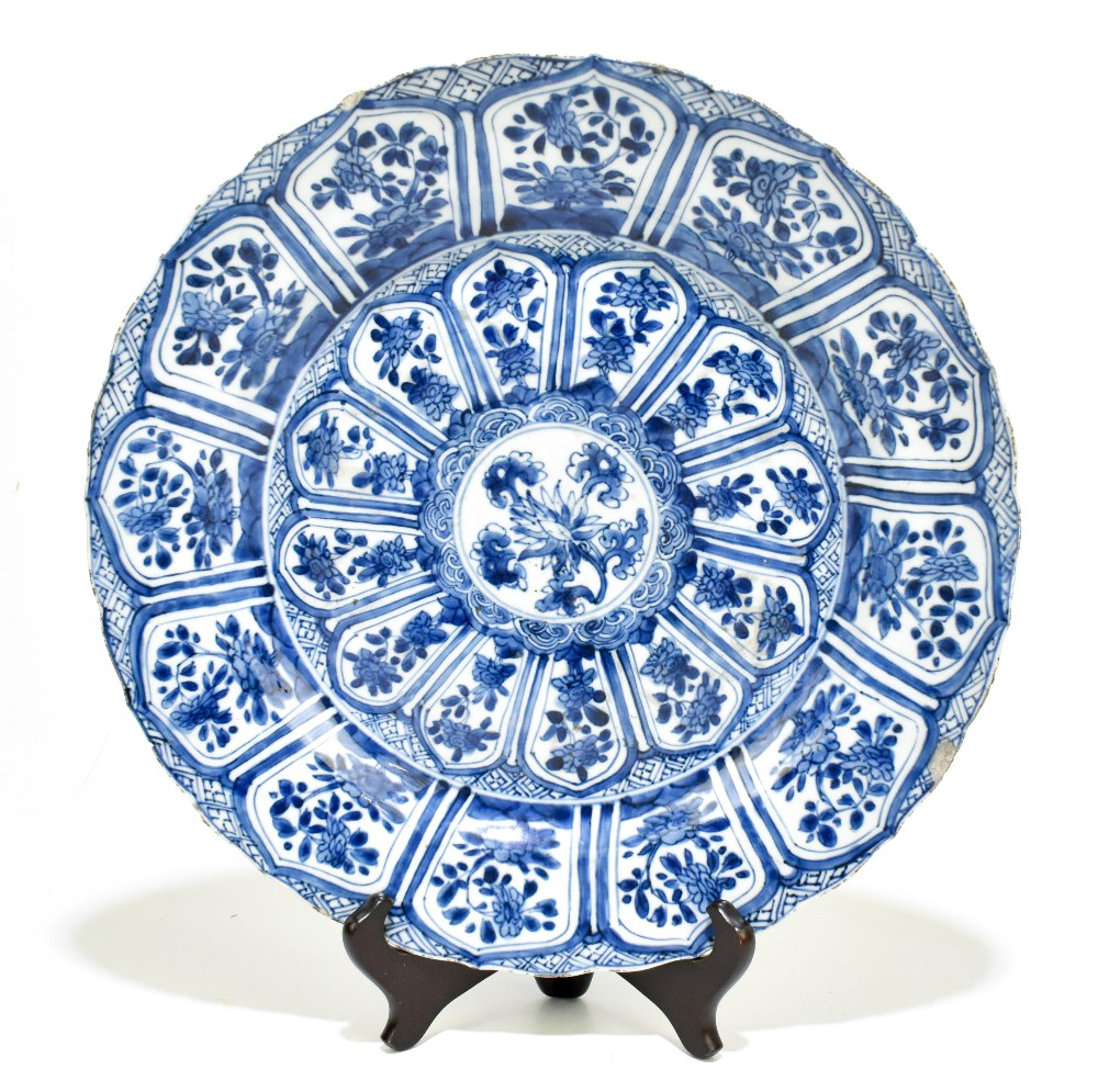An 18th century Chinese Export blue and white porcelain wall charger with central stylised floral