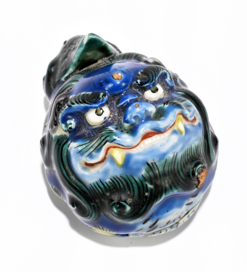 A Chinese porcelain trinket box and cover representing a Dog of Fo, height 8cm.Additional