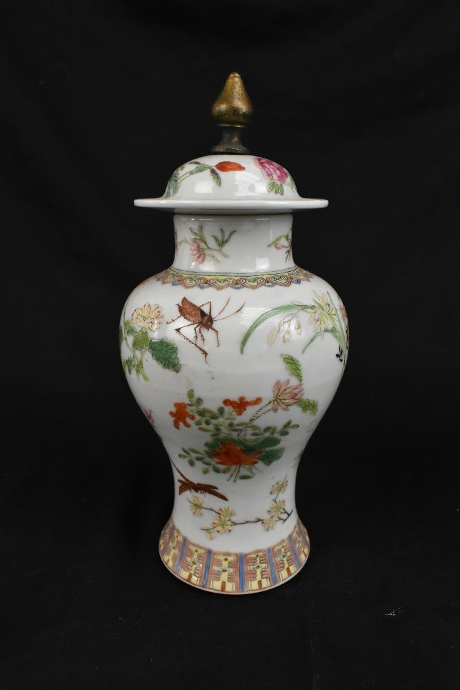 A pair of early 20th century Chinese porcelain Famille Rose temple jars and covers painted with - Image 3 of 16