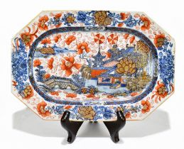 An 18th century Chinese clobbered blue and white octagonal dish, decorated with a harbour scene,