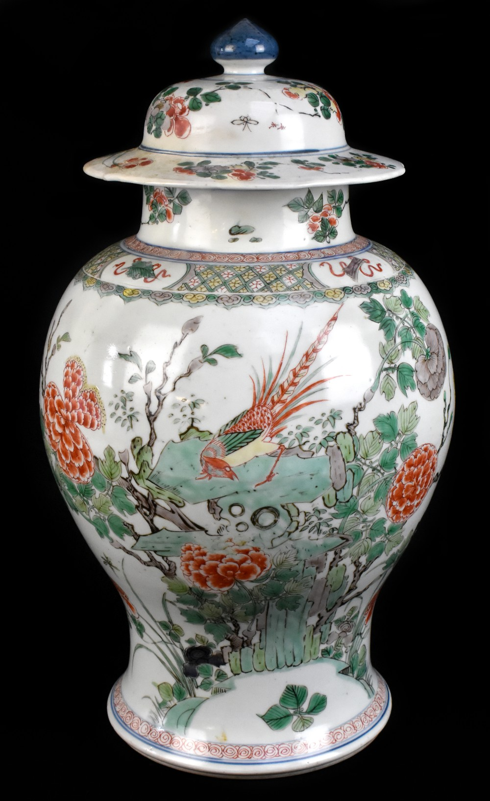 A 19th century Chinese Famille Verte Wucai porcelain temple jar and cover painted with a band of