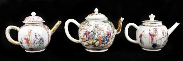 Three 18th century Chinese Famille Rose bullet shaped teapots including an example with figures