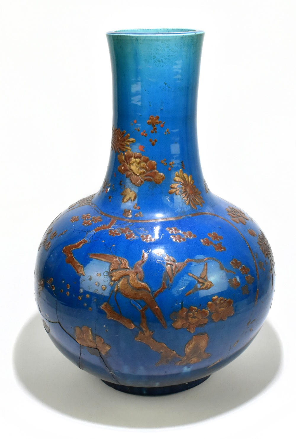 A large and impressive Chinese ceramic baluster form vase with relief chinoiserie decoration