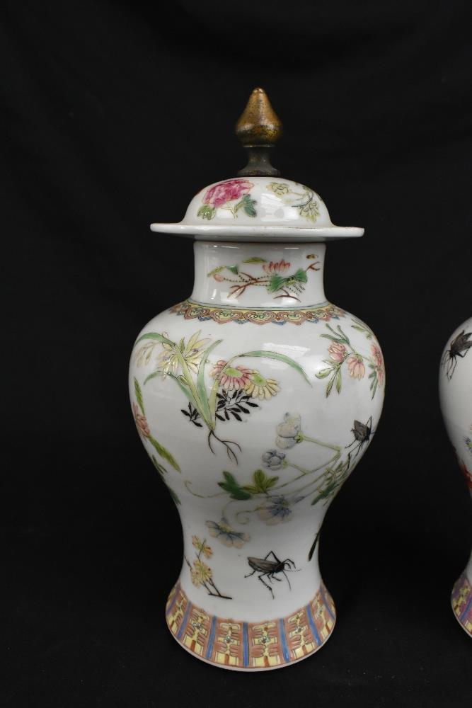 A pair of early 20th century Chinese porcelain Famille Rose temple jars and covers painted with - Image 2 of 16