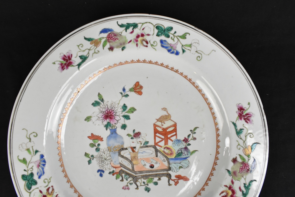 An 18th century Chinese porcelain Famille Rose wall charger decorated with objects to the centre - Image 3 of 6