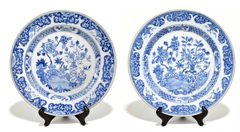 A pair of 18th century Chinese Export blue and white chargers painted with still life scenes and