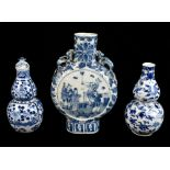 A late 19th century Chinese blue and white porcelain twin handled moon flask with moulded handles